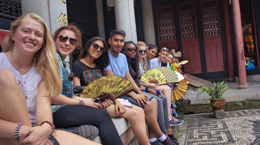 Volunteers doing teenage community work in China, visit a temple over the weekend.